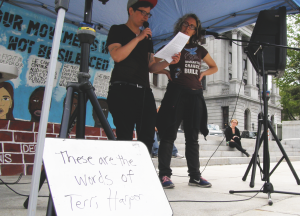 Layne and Emily read the words of Terri Harper at a protest against the Silencing Act at the State Capitol in April of 2015.